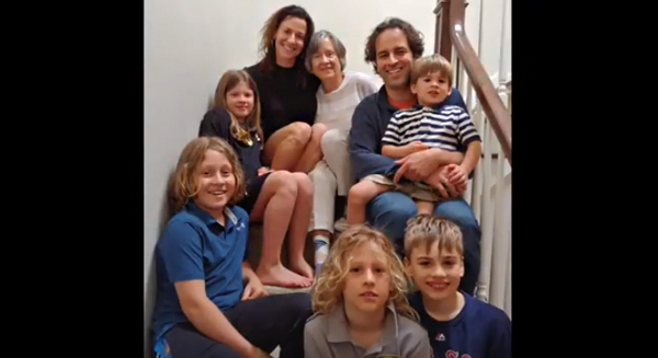 Video screenshot of Brenda Battat with daughter, son and grandchildren