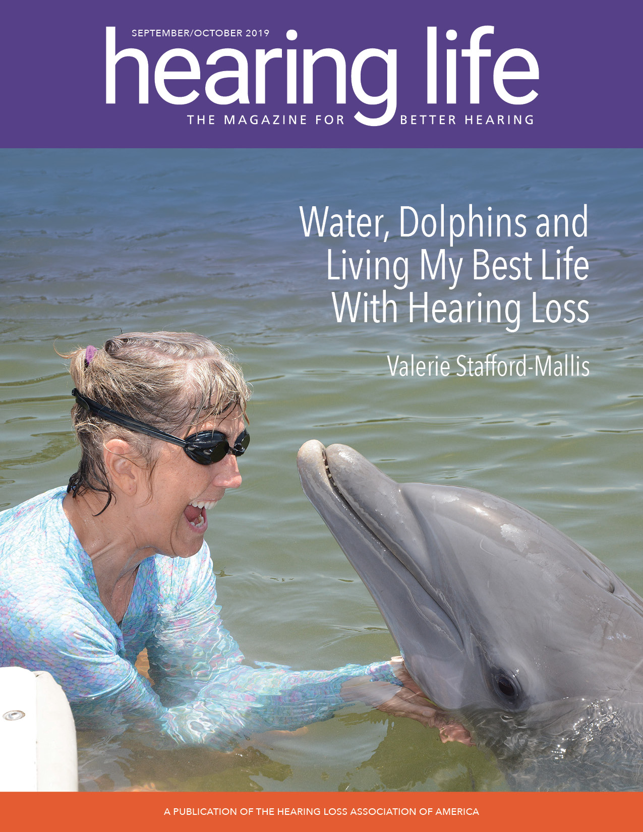 HLAA Hearing Life 2019 September/October Cover with Valerie Stafford-Mallis in the water with a dolphin