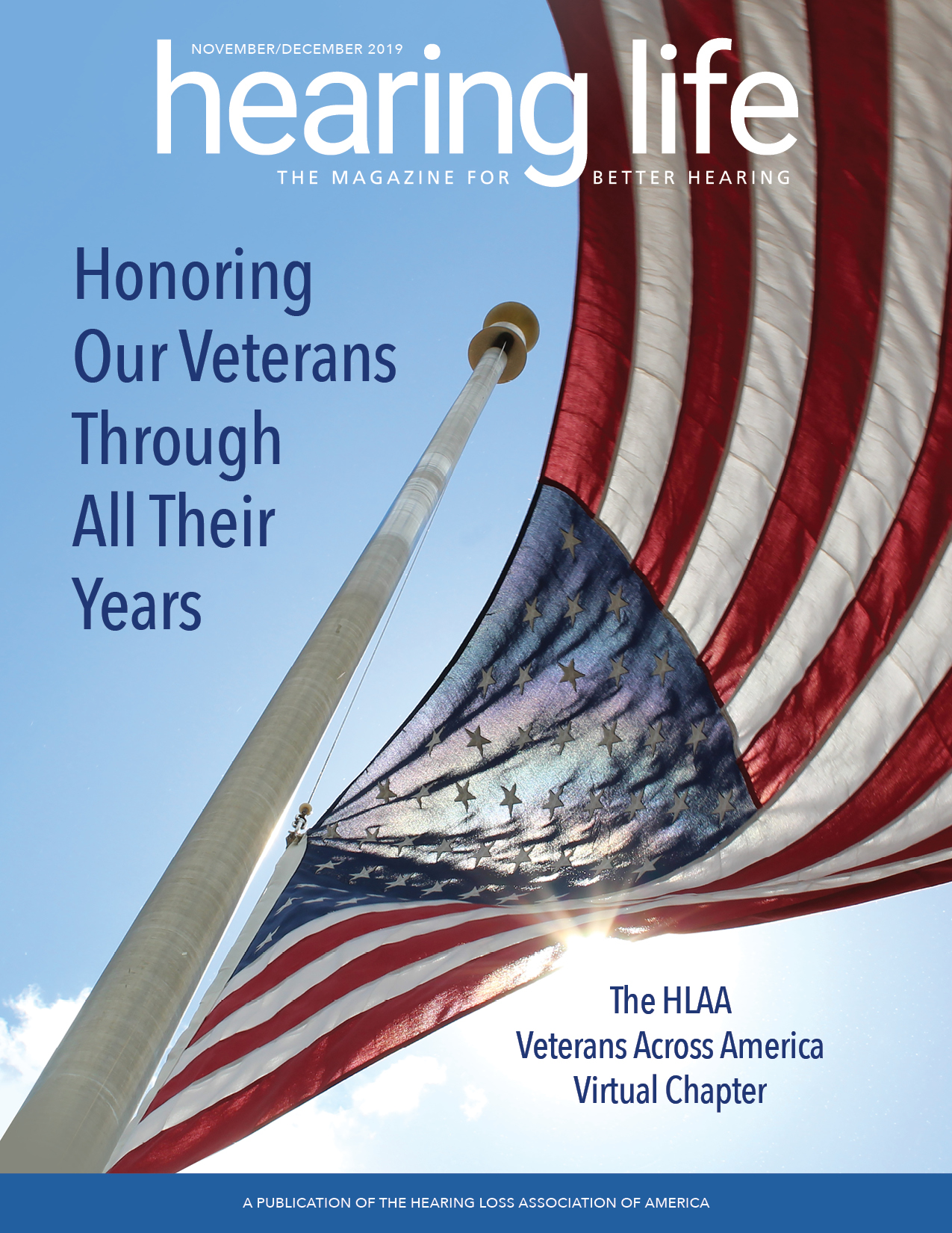 HLAA Hearing Life 2019 November/December Cover with an American flag waving in the wind with blue skies