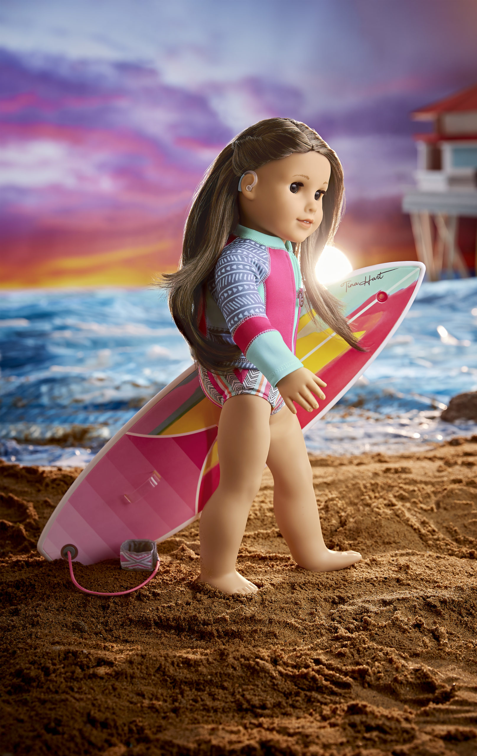 Joss - American Girl doll of the year 2020 - posing on the beach with a surf board