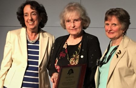 Karen Peltz-Strauss, Sheila Conlon-Mentkowski holding the award plaque and Lise Hamlin receiving the award