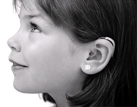 child wearing a hearing aid