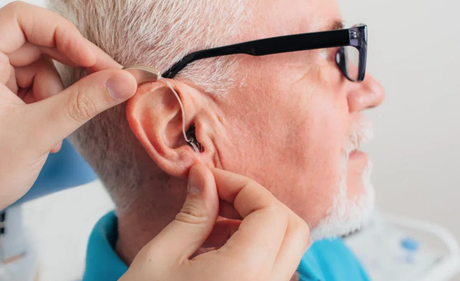 Man getting fitted with hearing aid