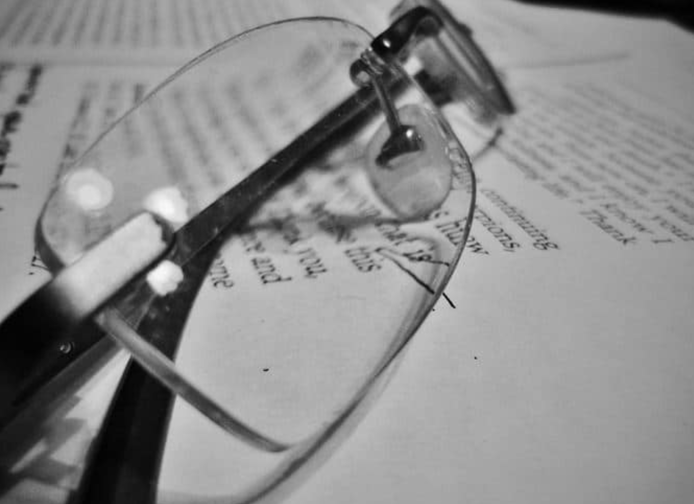Photo of bifocal glasses on a book
