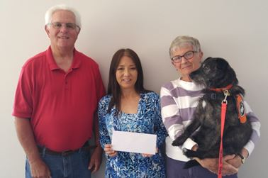 Michael Sweeney, HLAA chapter president, Rieko Darling, and Charlene MacKenzie, co-founder of the chapter in 2004 (shown with her hearing service dog, Lola.)