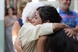 girl hugging her grandmother