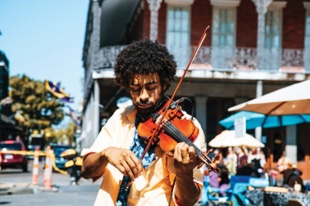 man playing a violin in the streets of New Orleans